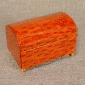 Tulip burl wood, Small chest, musical jewelry box with felt interior, jewelry compartment and ring holder.  Measures 5 3/4 x 3 3/4 x 4